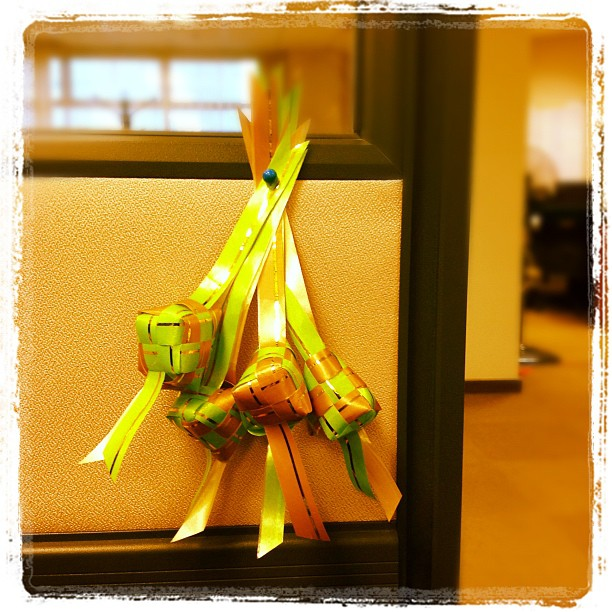 Mini ketupat hanging from my cubicle.